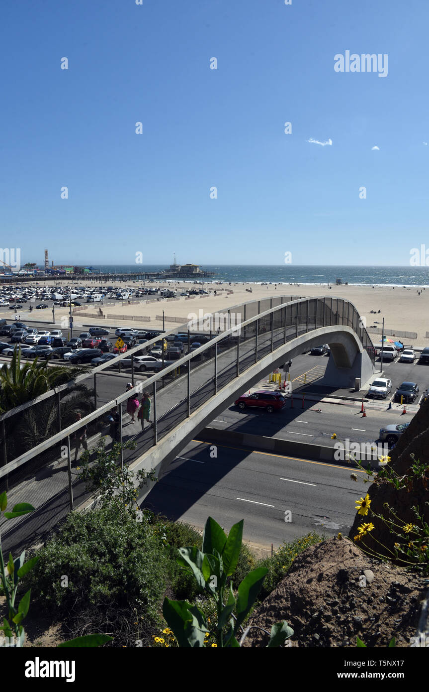 LOS ANGELES, CA/USA  - APRIL 11, 2019: Pedestrian bridge over the Pacific Coast Highway links the Santa Monica Beach to the city - Stock Image