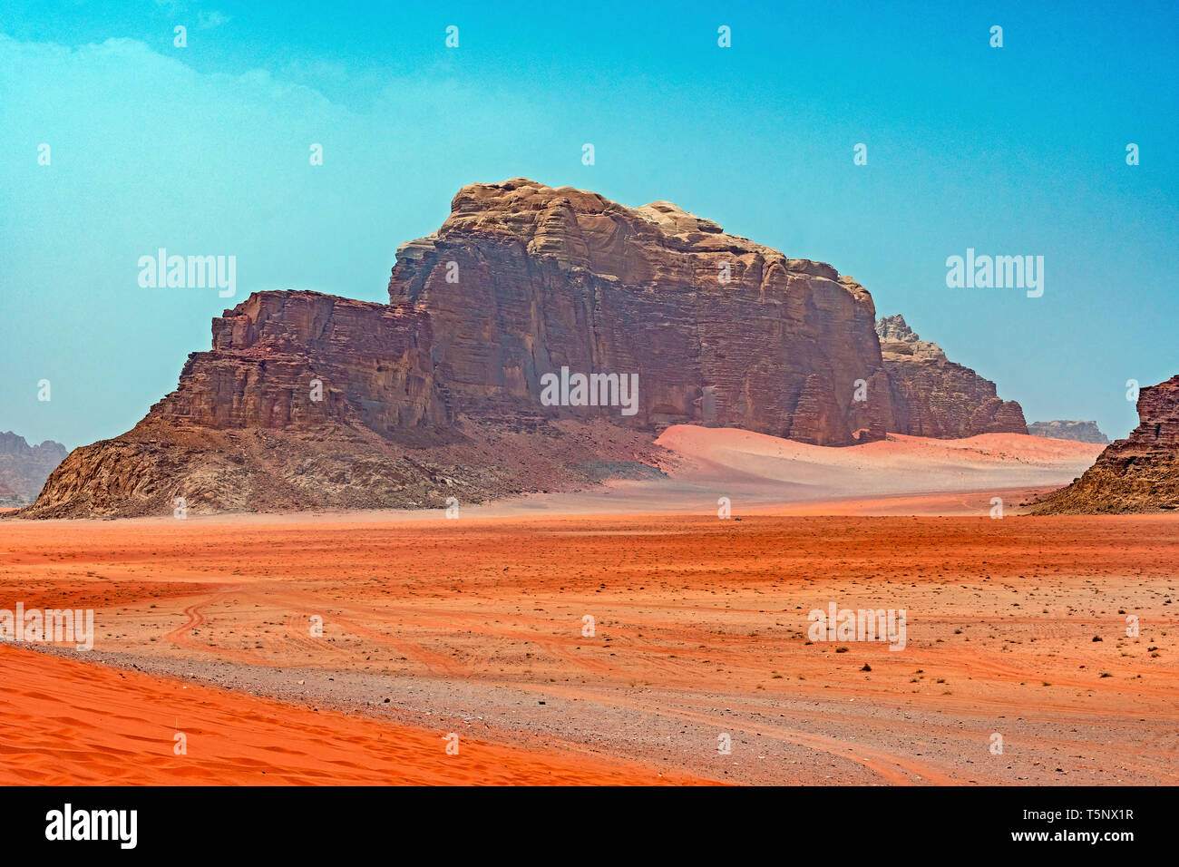 Distant Buttes in a Red Sand Desert in Wadi Rum in Jordan - Stock Image
