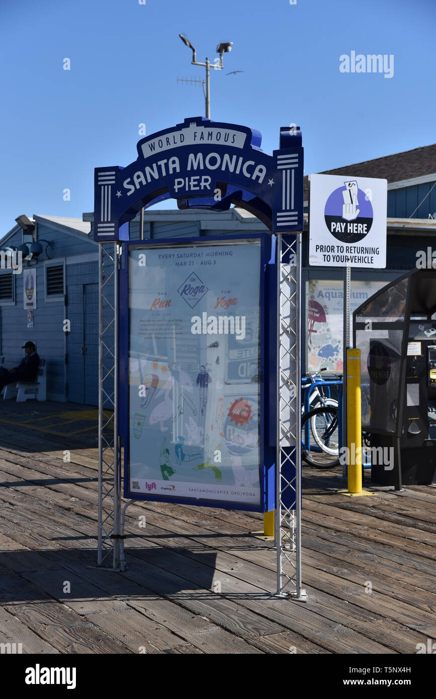 LOS ANGELES, CA/USA  - APRIL 11, 2019: Information sign at the entrance to the famous Santa Monica Pier in California - Stock Image