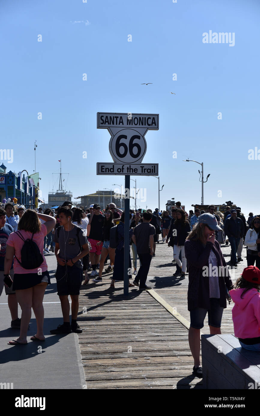 LOS ANGELES, CA/USA  - APRIL 11, 2019: Sign marking the western end of the historic Route 66 on the Santa Monic Pier - Stock Image