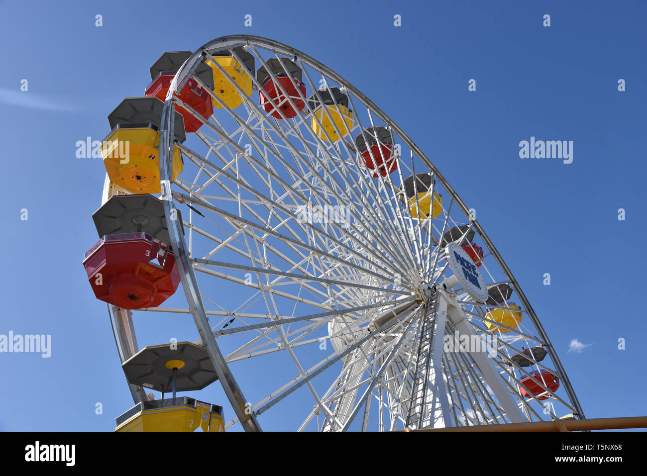 LOS ANGELES, CA/USA  - APRIL 11, 2019: The ferris wheel at Pacific Park on the Santa Monica Pier, a famous tourist attraction - Stock Image