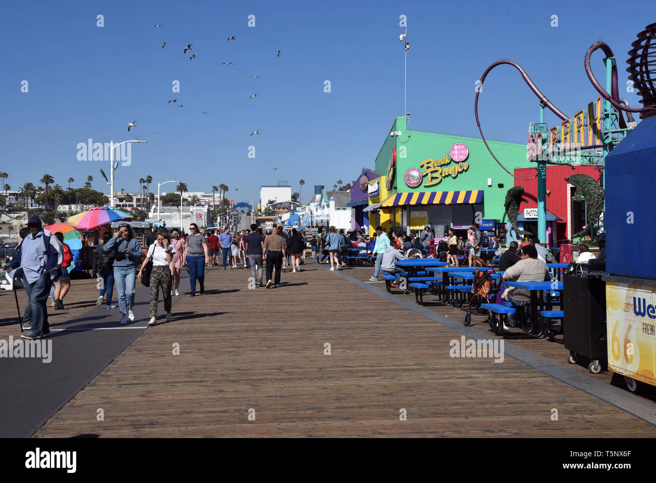 LOS ANGELES, CA/USA  - APRIL 11, 2019:  Thousands of tourists enjoying the Santa Monica Pier on a summer day - Stock Image