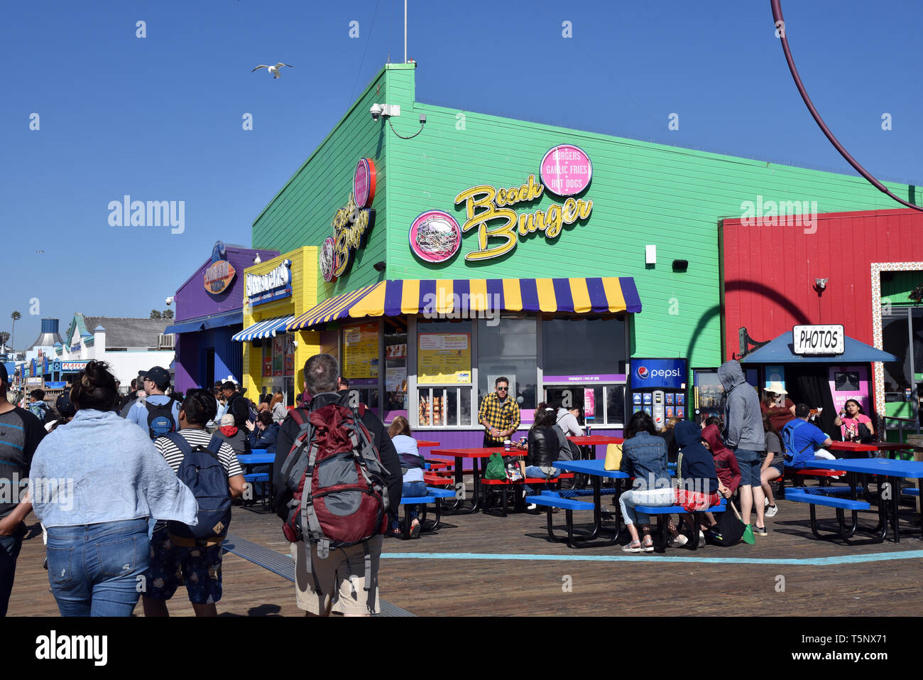 LOS ANGELES, CA/USA  - APRIL 11, 2019:  Cafes, shops and tourists enjoying the Santa Monica Pier on a summer day - Stock Image