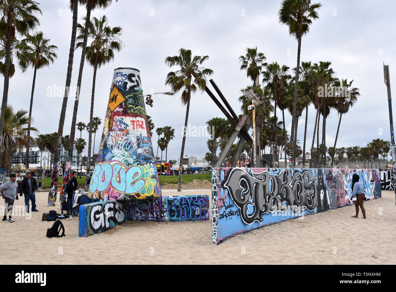 LOS ANGELES, CA/USA  - APRIL 19, 2019:  Tourists and taggers or graffiti artists at the Venice Beach Graffiti Walls - Stock Image
