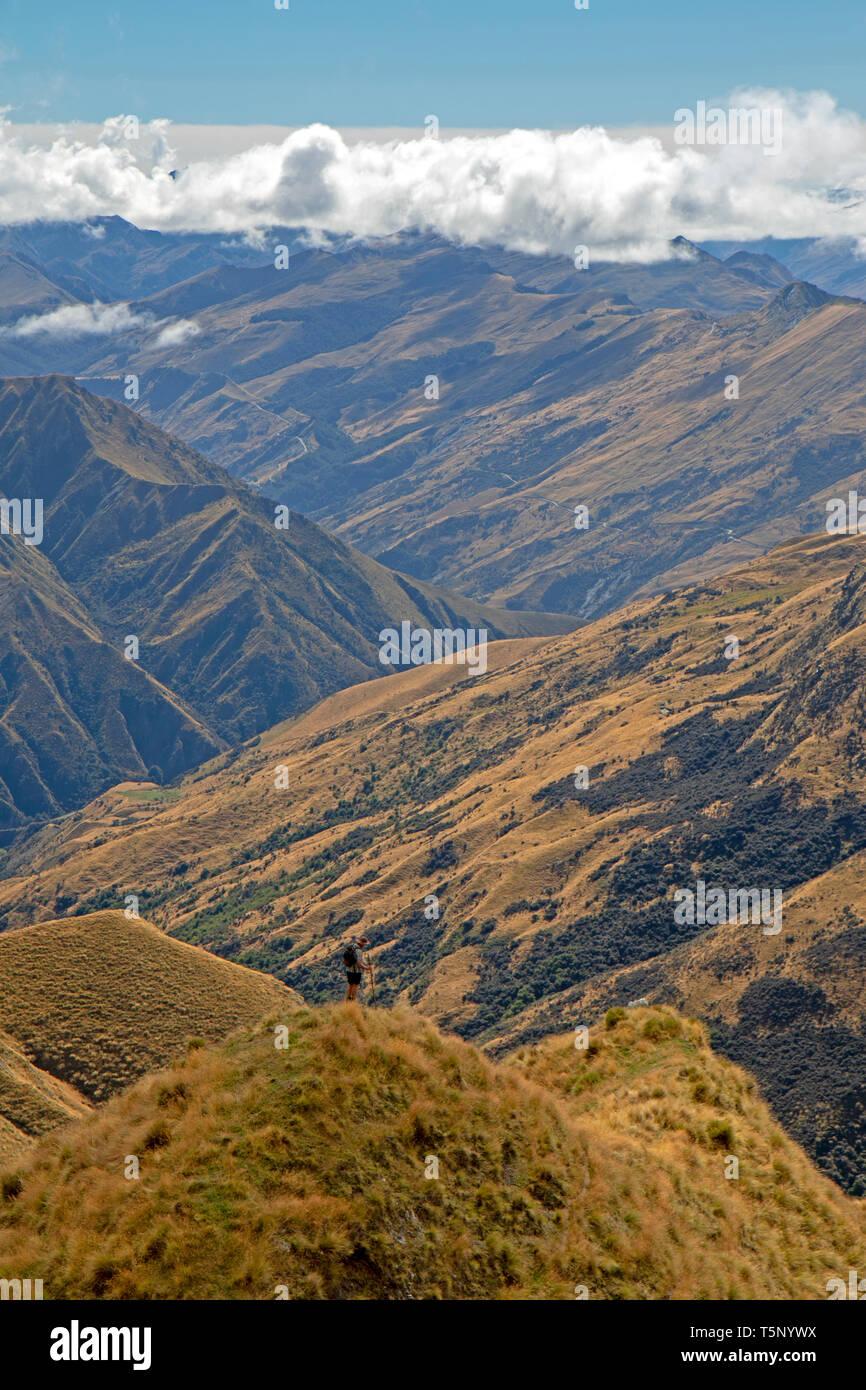 Man standing on a ridge on the slopes of Ben Lomond - Stock Image