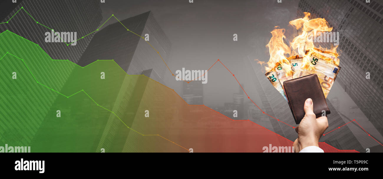 Loosing money concept - burning Euro bills in front of a declining graph - Stock Image
