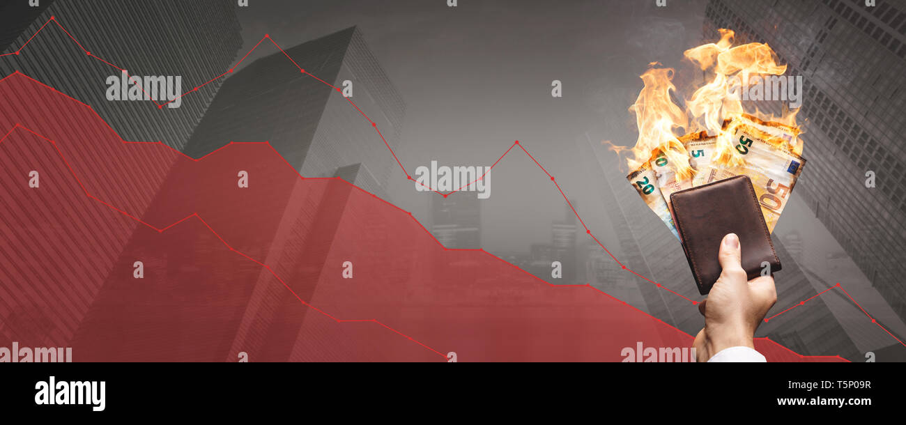 Falling stock prices – burning Euro bills in front of a declining graph - Stock Image