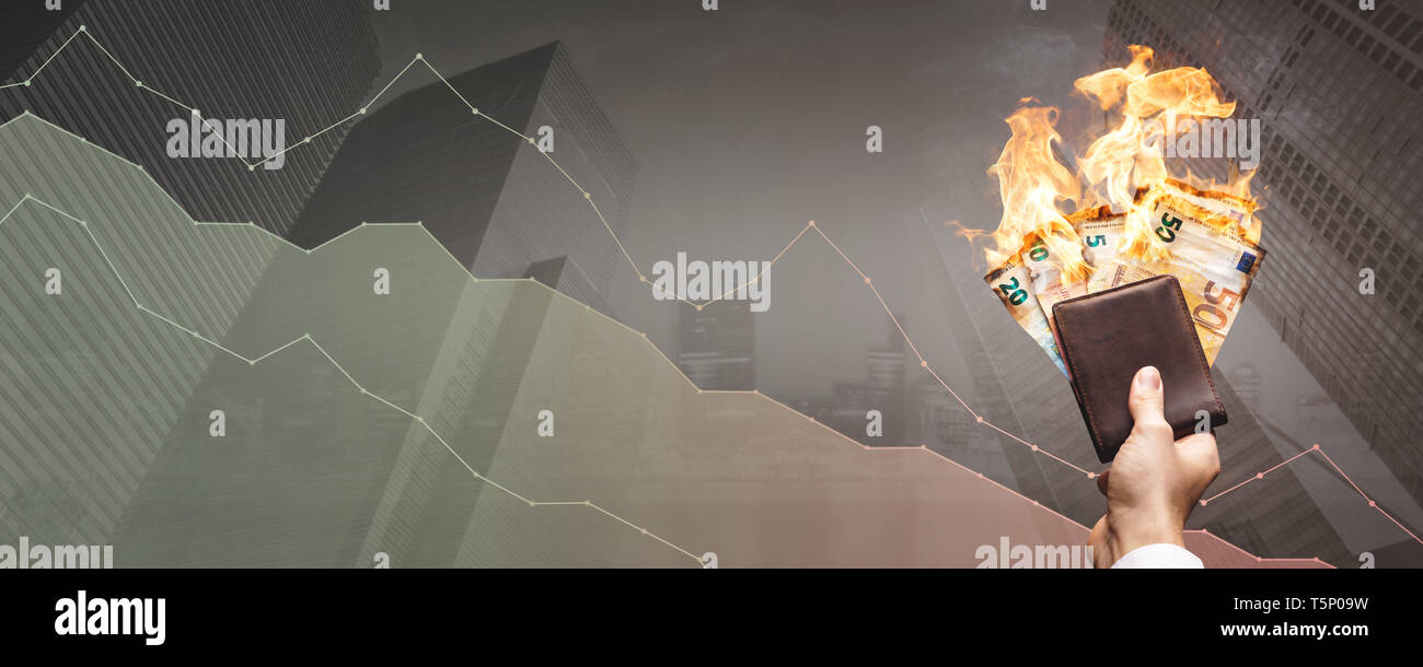 Depreciation concept – burning Euro bills in front of a declining graph - Stock Image