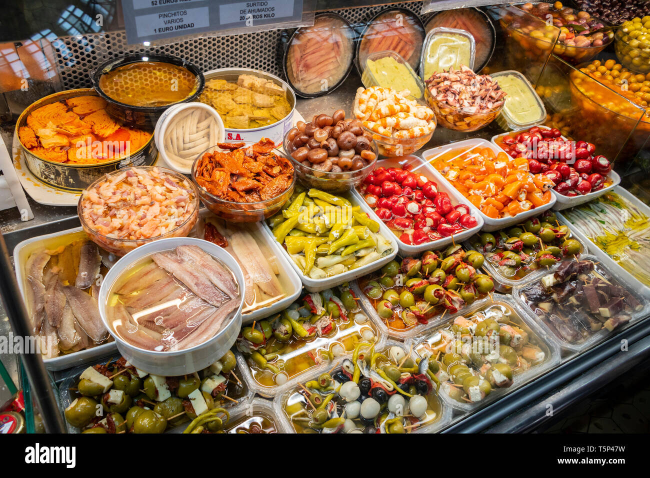 Spanish deli stall with olives and anchovies in Central Market Valencia Spain - Stock Image