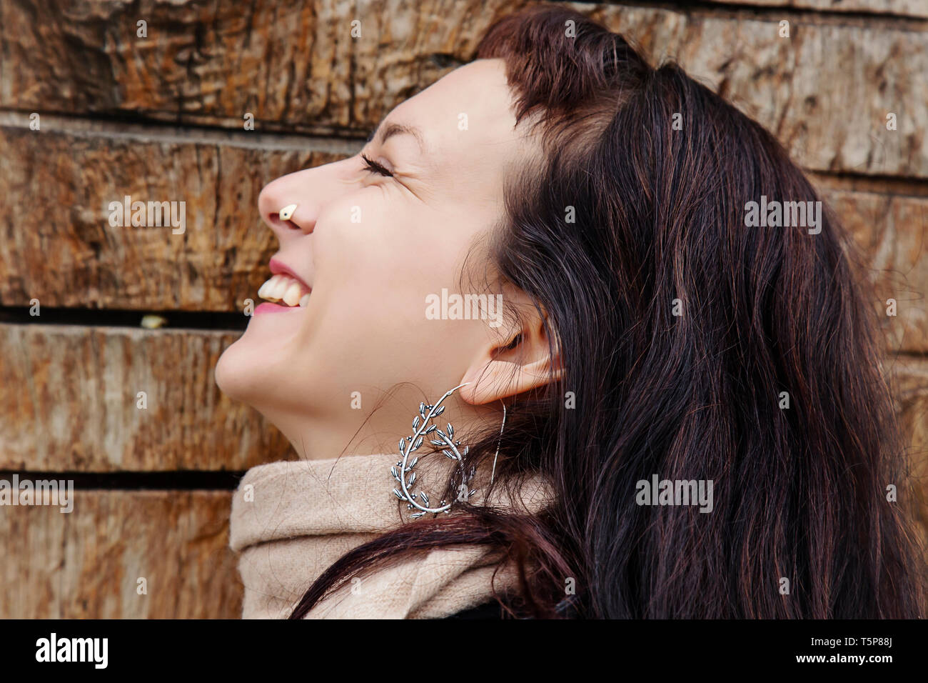 9b7b6f9f2 Outdoor close up portrait of beautiful woman wearing silver earrings -  Stock Image