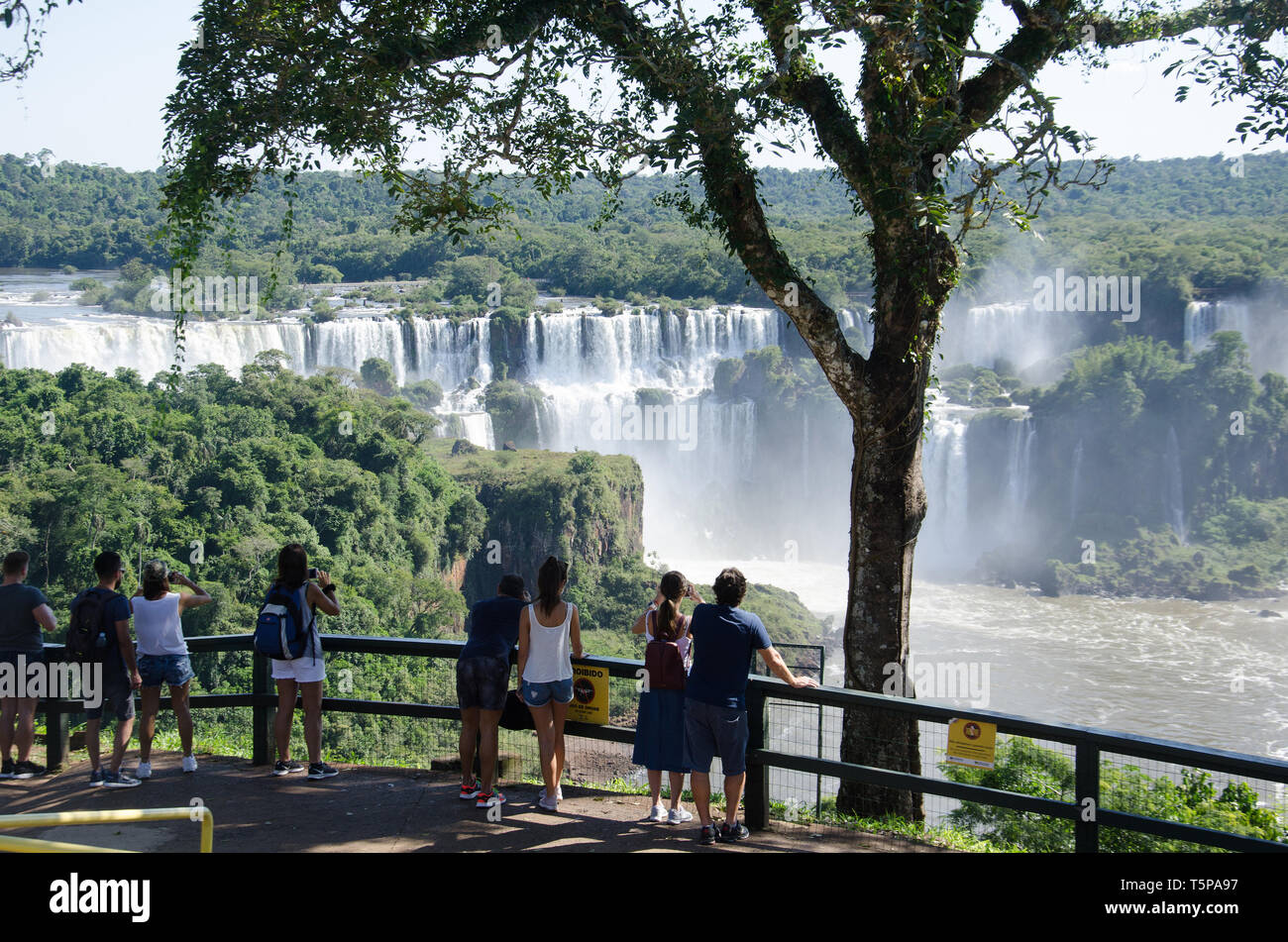 Visitors view the spectacular Iguaçu falls from the Brazilian side Stock Photo