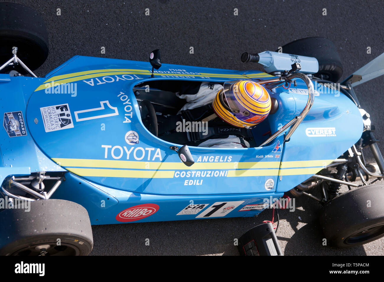 Close-up, aerial view of Kieth White driving his 1977, Ralt RT1 Formula 3 race car at the 2019 Silverstone Classic media day. - Stock Image