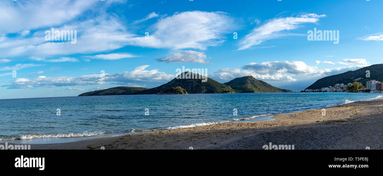 Small town Tolo, located near Nafplio in cozy sea bay with clear water and fine sand, summer vacation destination for families with kids, Peloponnese, - Stock Image