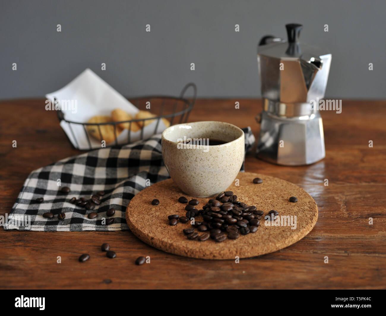 Moka pot coffee maker and coffee cup, steel italian espresso coffee pot - Stock Image