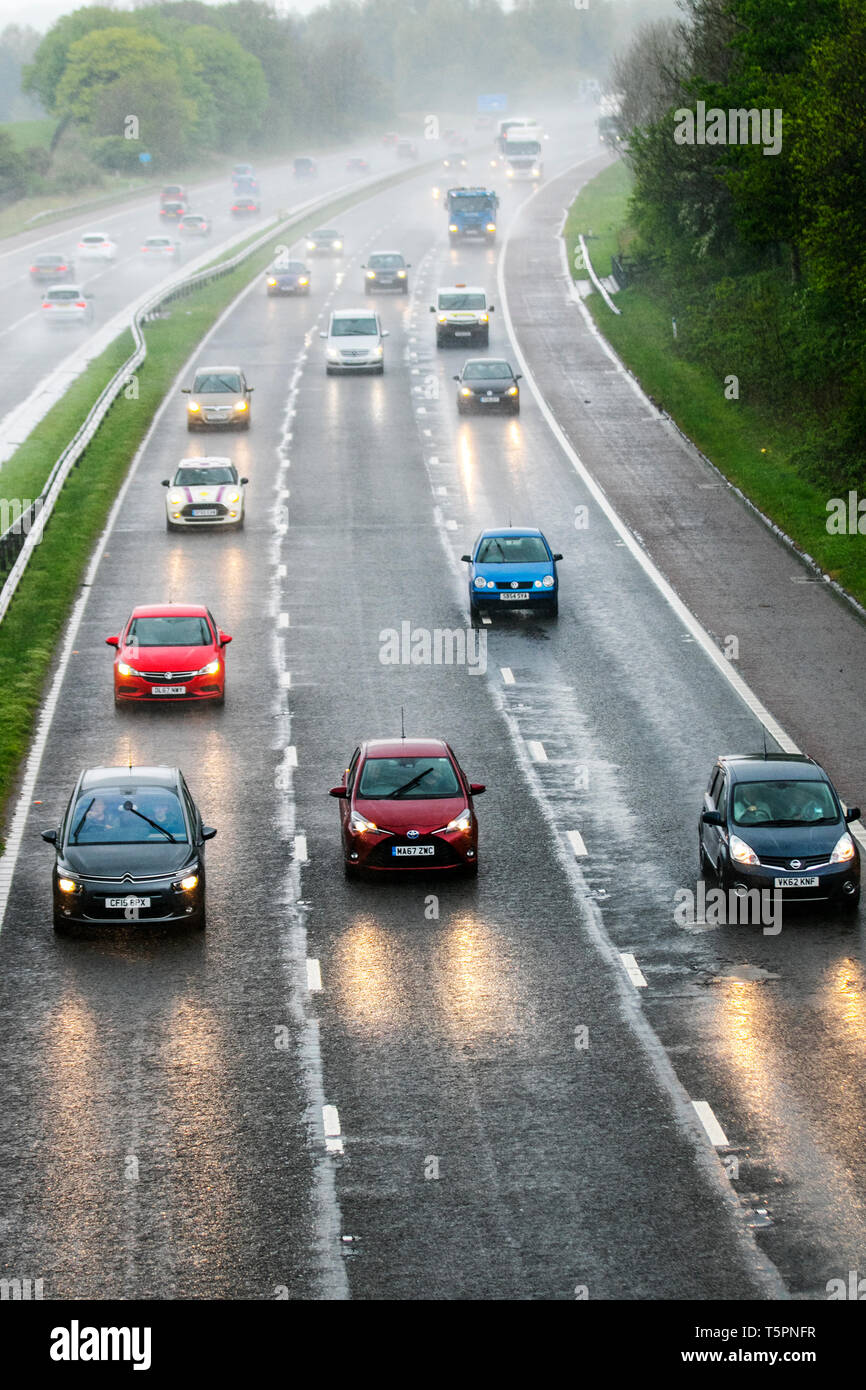 Lancaster, Lancashire. 26th April, 2019. UK Weather. Heavy rain in the north-west on the M6 as storm Hannah approaches. Severe weather warnings have been issued and drivers heading home for the weekend are facing increasing difficult driving conditions, Credit: MediaWorldImages/Alamy Live News Stock Photo