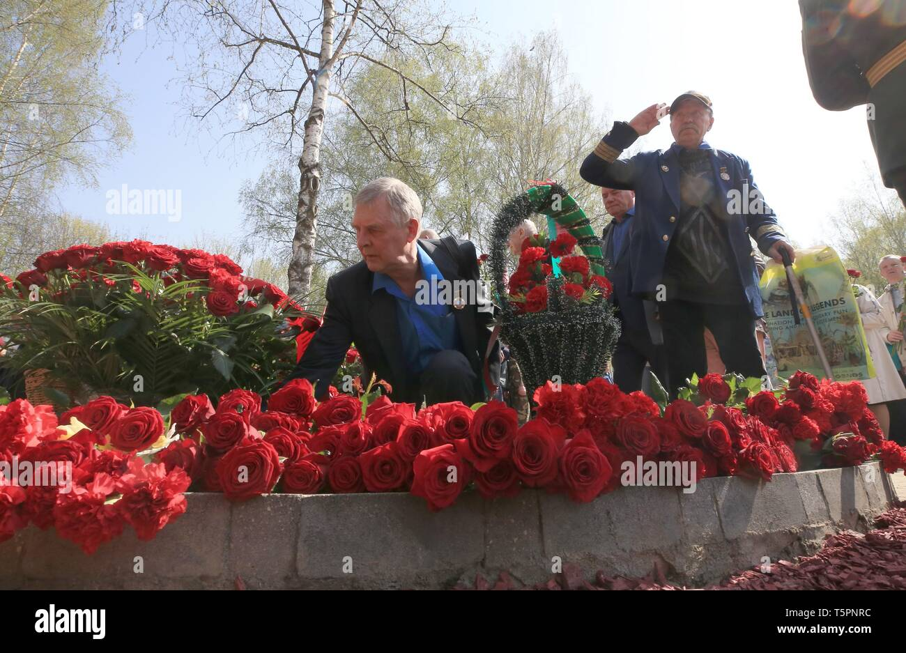Minsk, Belarus. 26th Apr, 2019. People lay flowers to commemorate the victims of the Chernobyl disaster in Minsk, Belarus, April 26, 2019. The Chernobyl nuclear power plant, some 110 km north of the Ukrainian capital Kiev, witnessed one of the worst nuclear accidents in human history on April 26, 1986, when a series of explosions ripped through the No.4 reactor, spreading radiation across Ukraine, Belarus, Russia and other European countries. Credit: Efim Mazurevich/Xinhua/Alamy Live News - Stock Image