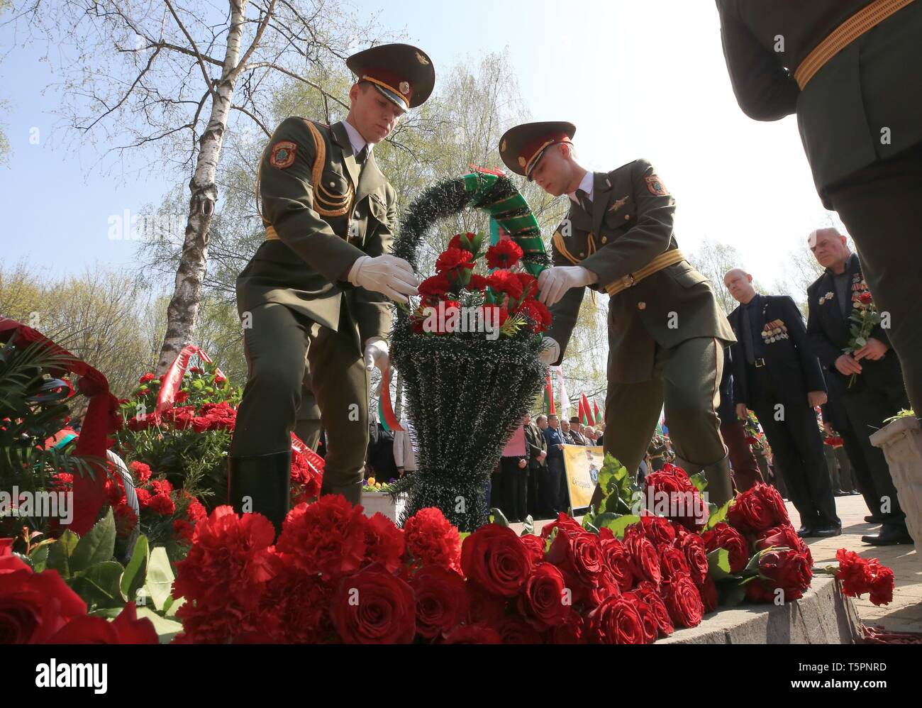 Minsk, Belarus. 26th Apr, 2019. Soldiers lay flowers to commemorate the victims of the Chernobyl disaster in Minsk, Belarus, April 26, 2019. The Chernobyl nuclear power plant, some 110 km north of the Ukrainian capital Kiev, witnessed one of the worst nuclear accidents in human history on April 26, 1986, when a series of explosions ripped through the No.4 reactor, spreading radiation across Ukraine, Belarus, Russia and other European countries. Credit: Efim Mazurevich/Xinhua/Alamy Live News - Stock Image
