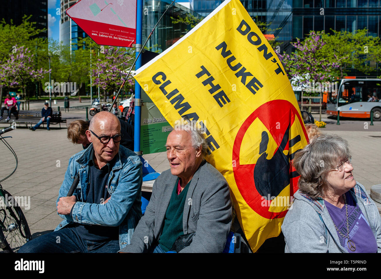 """April 26, 2019 - Brussels, North Brabant, Belgium - Two activists are seen seating while holding a big anti nuclear flag during the protest..On the day that commemorates the 33rd anniversary of the Chernobyl nuclear disaster, a protest was organized by the """"Fin du nucléaire"""" and Réveil Anti-Nucléaire"""" associations, as well as director Bouli Lanners. They want the five most dangerous Belgian reactors to be shut down. (Credit Image: © Ana Fernandez/SOPA Images via ZUMA Wire) - Stock Image"""