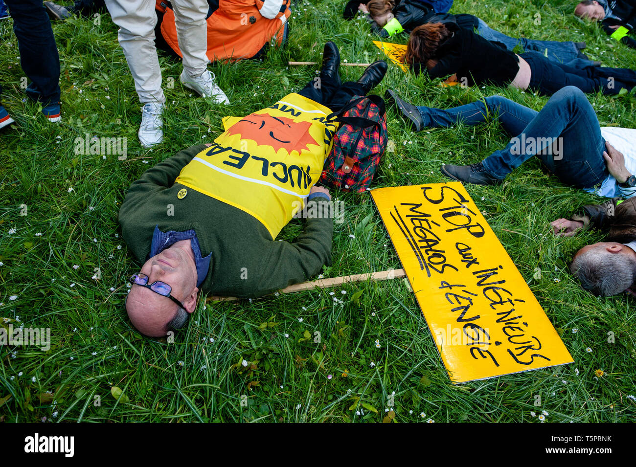 """April 26, 2019 - Brussels, North Brabant, Belgium - Some activists are seen laying dead in front of Engie HQ during the protest..On the day that commemorates the 33rd anniversary of the Chernobyl nuclear disaster, a protest was organized by the """"Fin du nucléaire"""" and Réveil Anti-Nucléaire"""" associations, as well as director Bouli Lanners. They want the five most dangerous Belgian reactors to be shut down. (Credit Image: © Ana Fernandez/SOPA Images via ZUMA Wire) - Stock Image"""