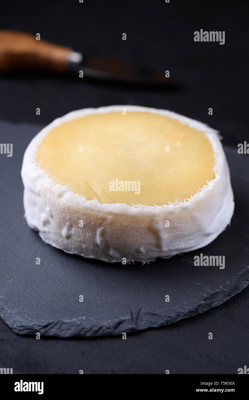 Soft cheese in cheesecloth - Stock Image