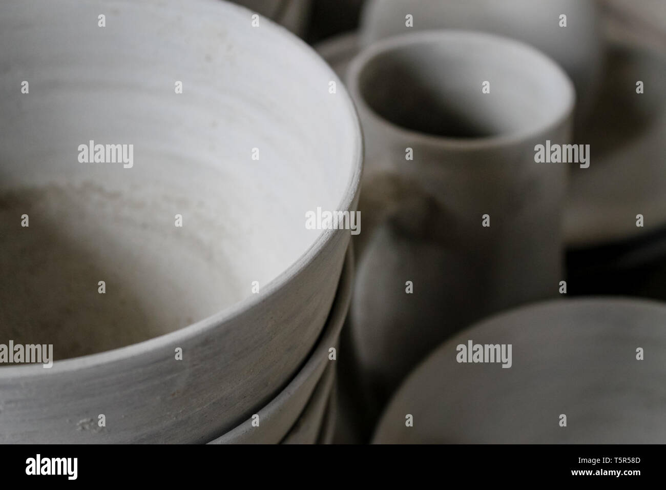 FEZ, MOROCCO - November 1, 2012: Handmade pottery goods stacked in columns in a pottery workshop in Fez, Morocco. - Stock Image