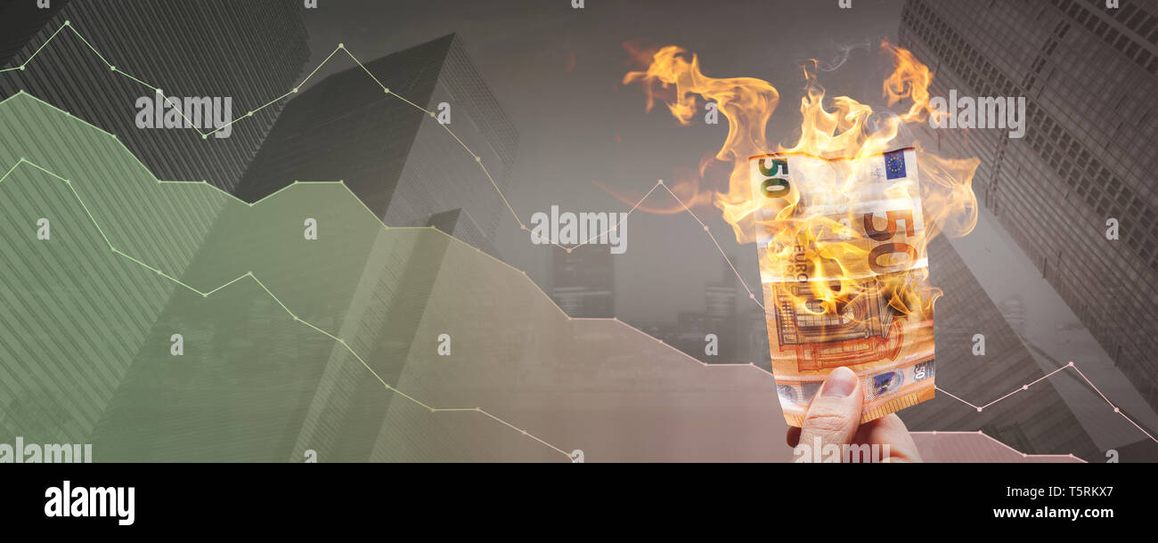 Depreciation concept – burning 50€ bill in front of a declining graph - Stock Image