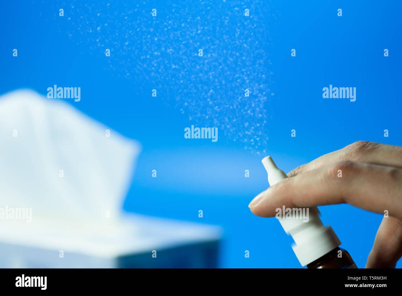 nasal spray and tissues - allergy and flu season concept Stock Photo