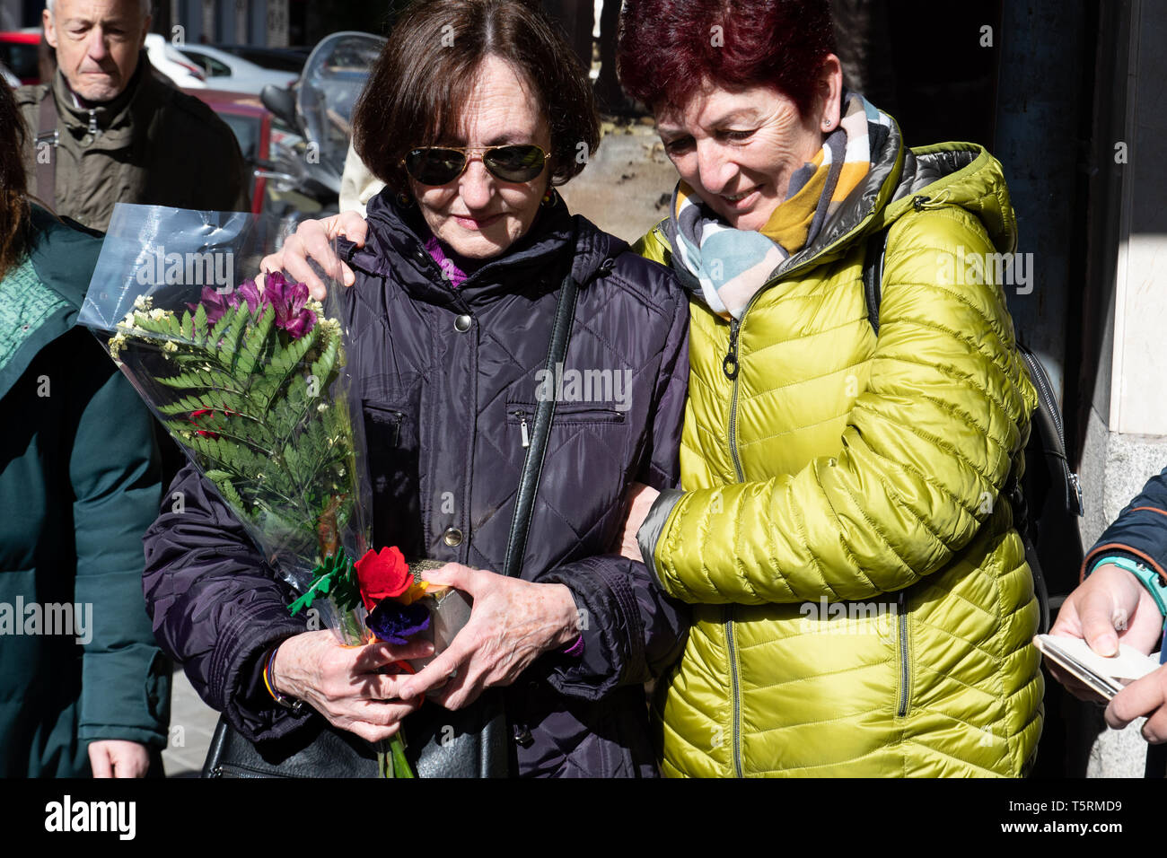 Madrid, Spain. 26th April, 2019. Maria Zurita (L) reacting after receiving the Stolperstein in the memory of her uncle, Antonio Zurita Mayo. - Stock Image
