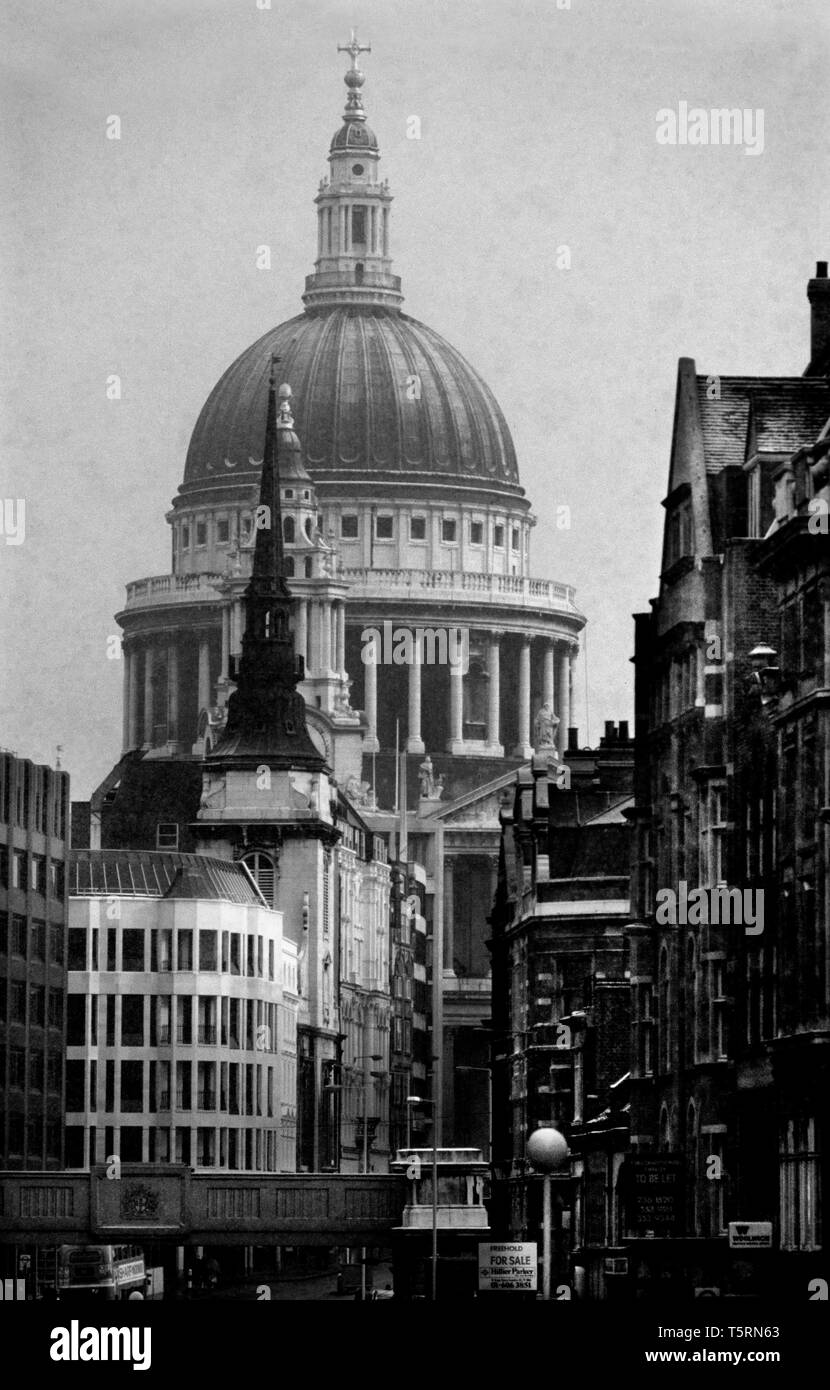 St Paul's Cathedral in the City of London, London England. 1980 St Paul's Cathedral, London, is an Anglican cathedral, the seat of the Bishop of London and the mother church of the Diocese of London. It sits on Ludgate Hill at the highest point of the City of London and is a Grade I listed building. Its dedication to Paul the Apostle dates back to the original church on this site, founded in AD 604. The present cathedral, dating from the late 17th century, was designed in the English Baroque style by Sir Christopher Wren. Its construction, completed in Wren's lifetime, was part of a major rebu - Stock Image