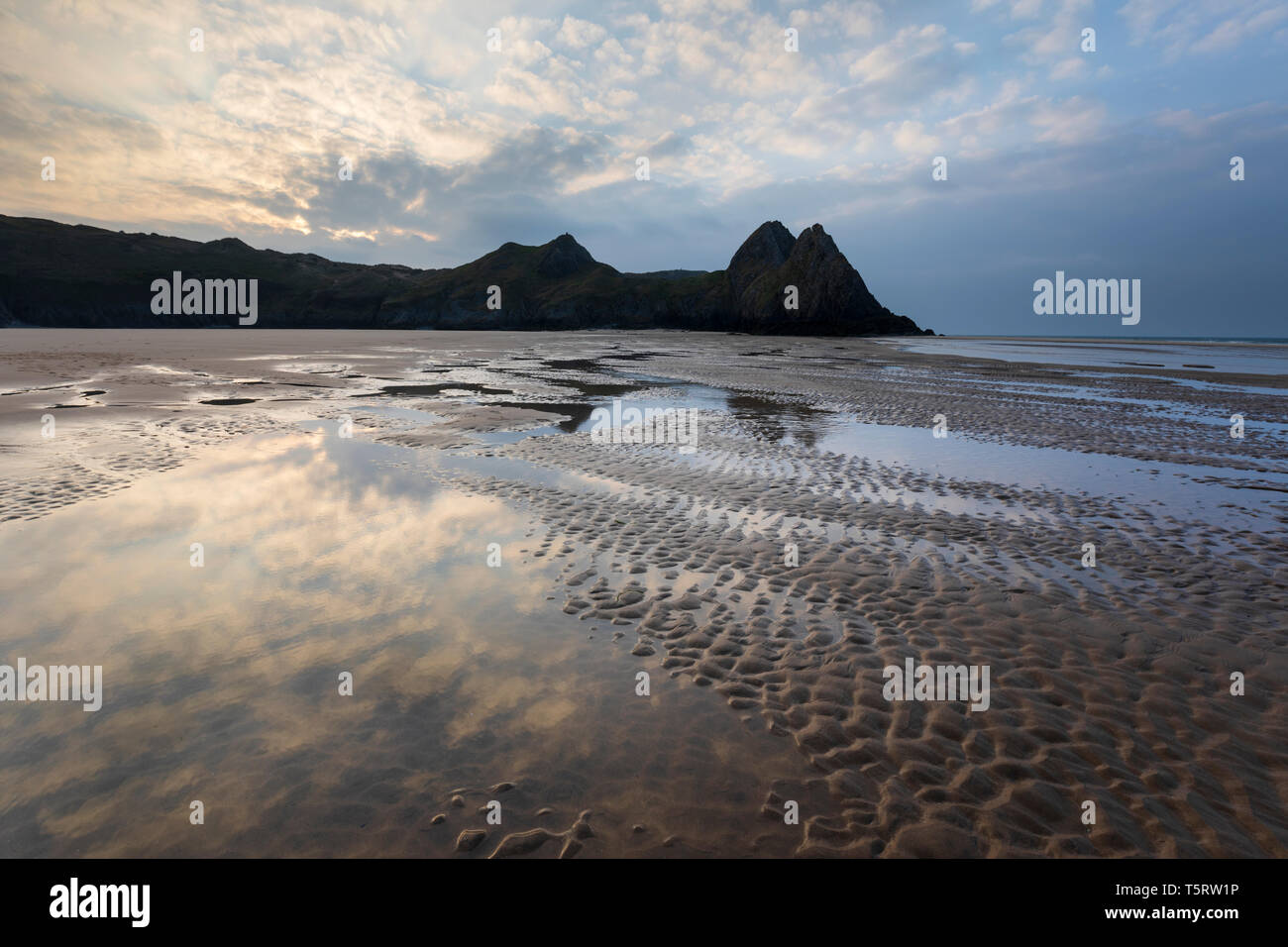 Three Cliffs Bay at sunrise with low tide, Gower Peninsula, Swansea, West Glamorgan, Wales, United Kingdom, Europe - Stock Image