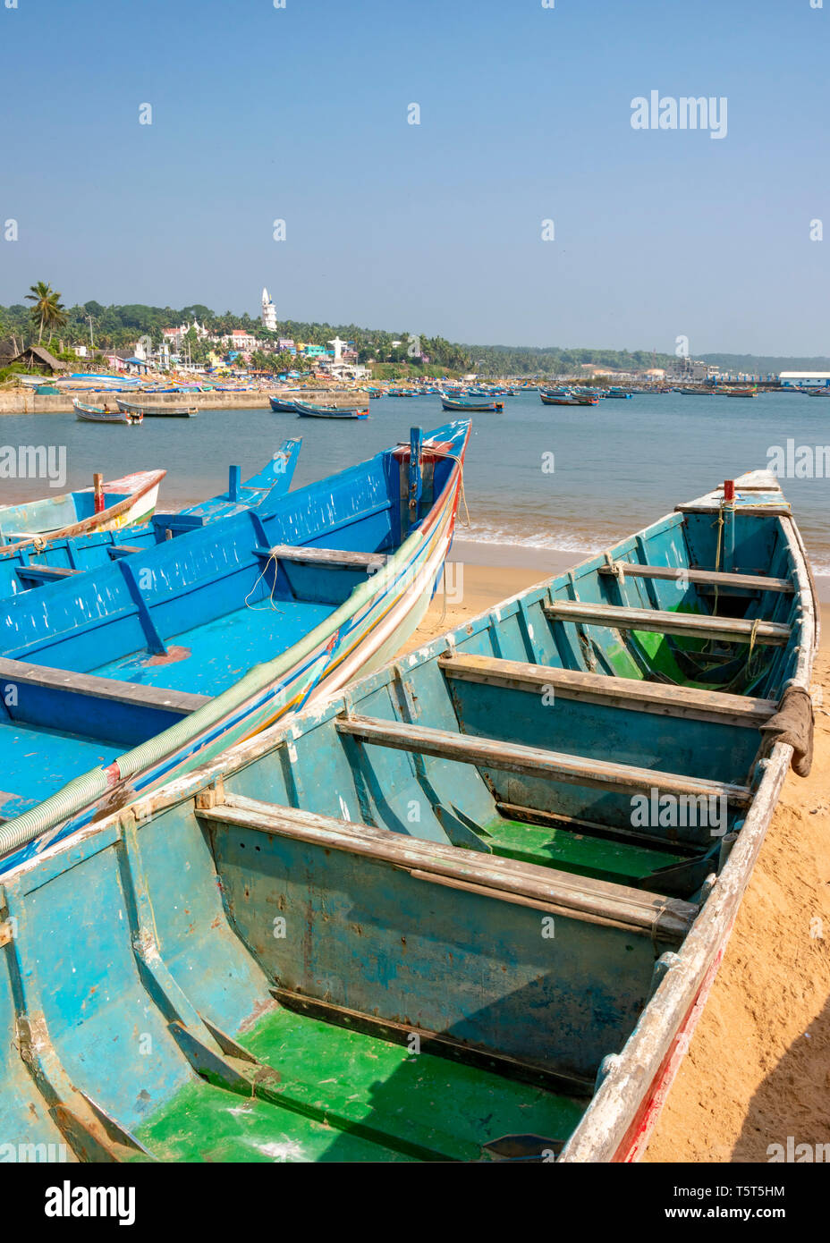 Vertical view of colourful fishing boats at Vizhinjam in Kerala, India. - Stock Image