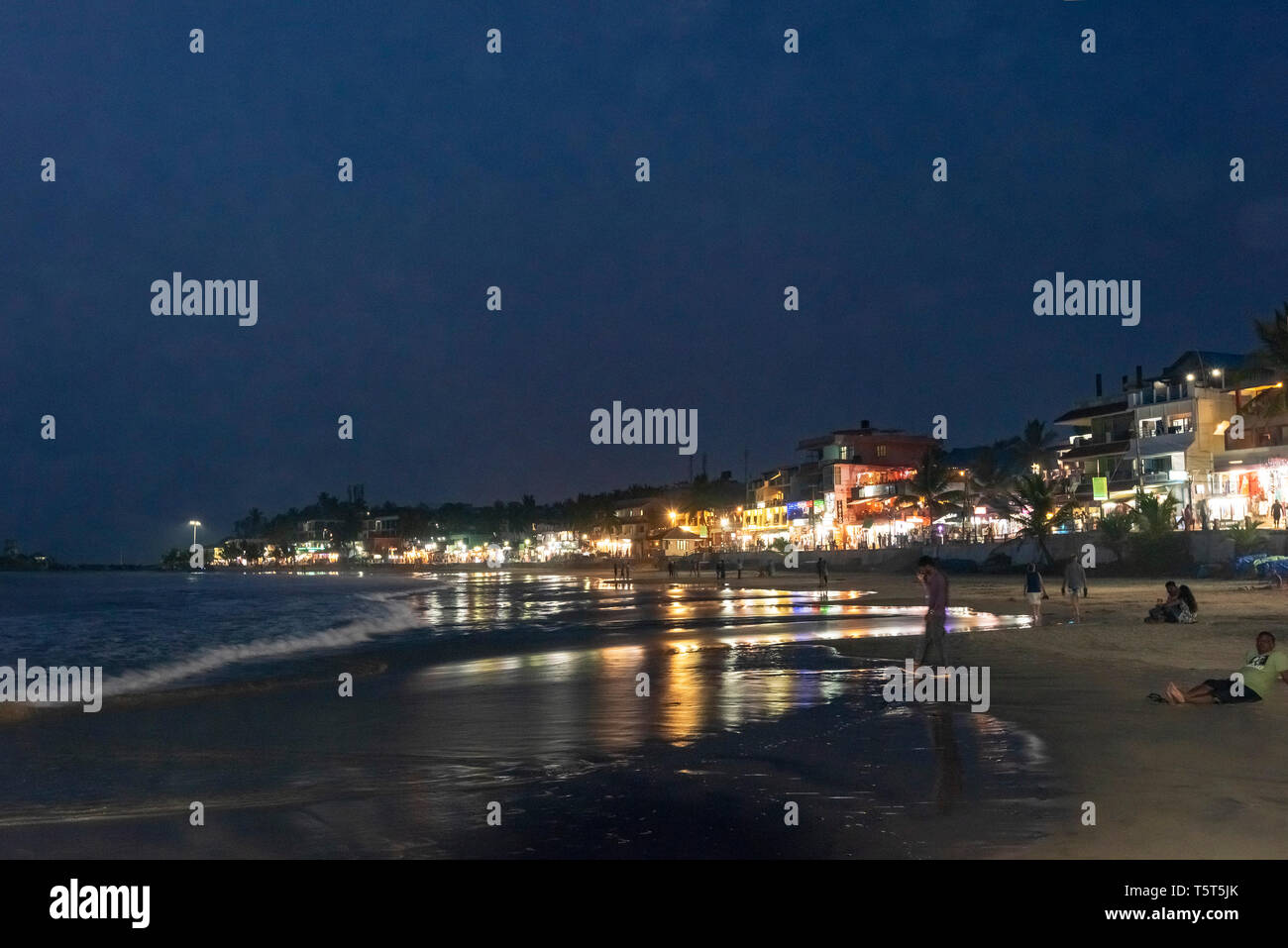 Horizontal view of Lighthouse beach in Kovalam Kerala at night, India. - Stock Image