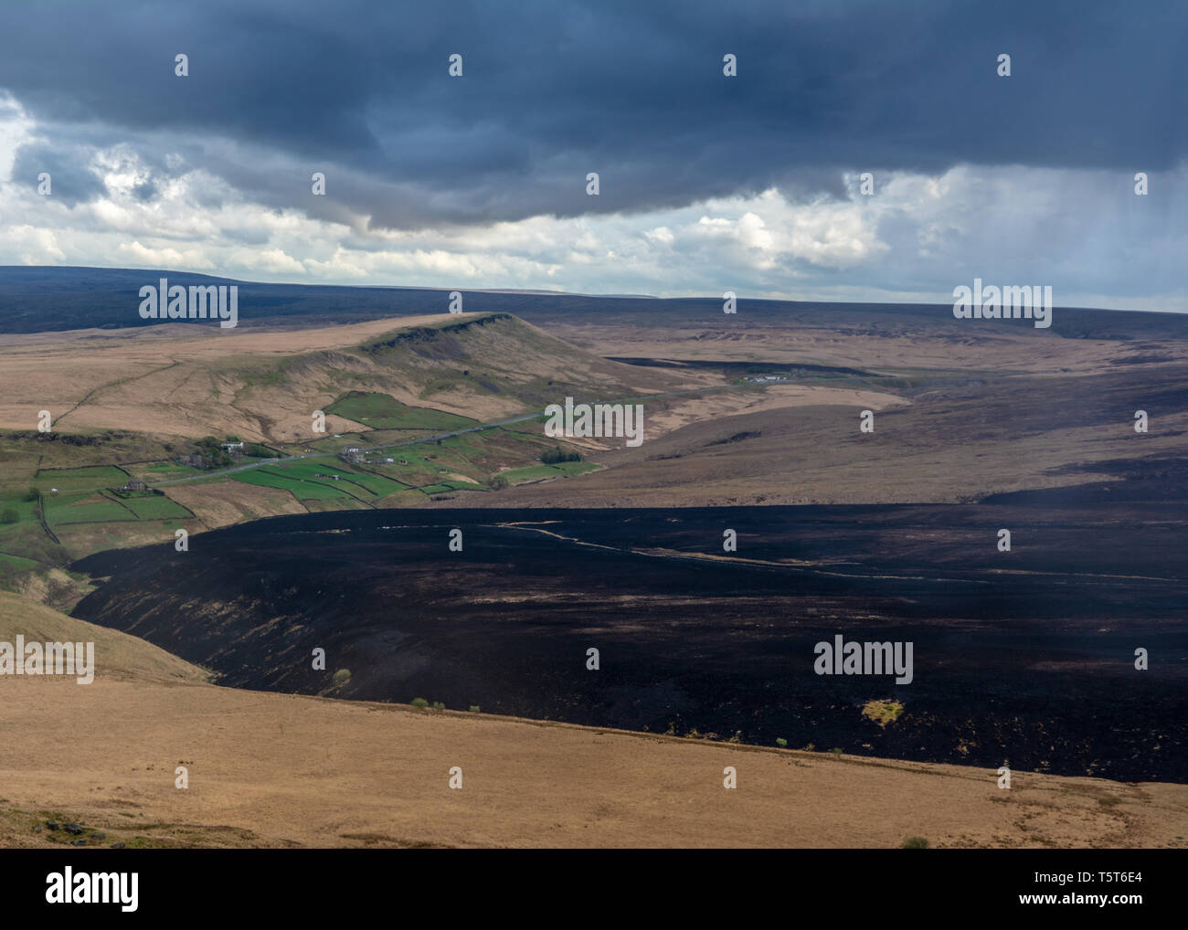 The aftermath of the fires over Marsden moors, with a huge section of the land now black. - Stock Image