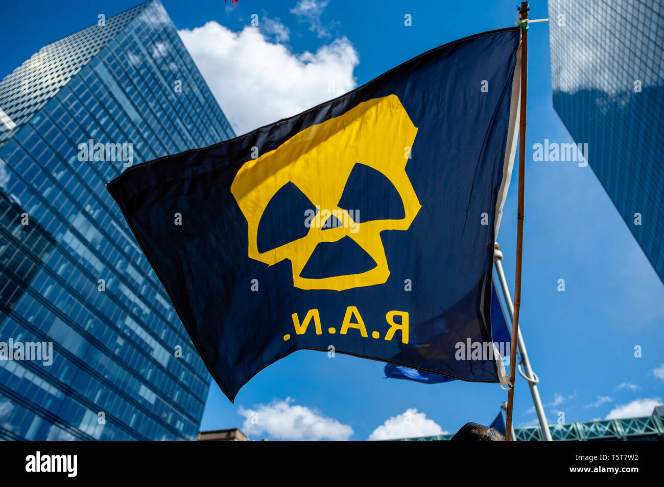 """An anti nuclear flag seen flying during the protest. On the day that commemorates the 33rd anniversary of the Chernobyl nuclear disaster, a protest was organized by the """"Fin du nucléaire"""" and Réveil Anti-Nucléaire"""" associations, as well as director Bouli Lanners. They want the five most dangerous Belgian reactors to be shut down. - Stock Image"""
