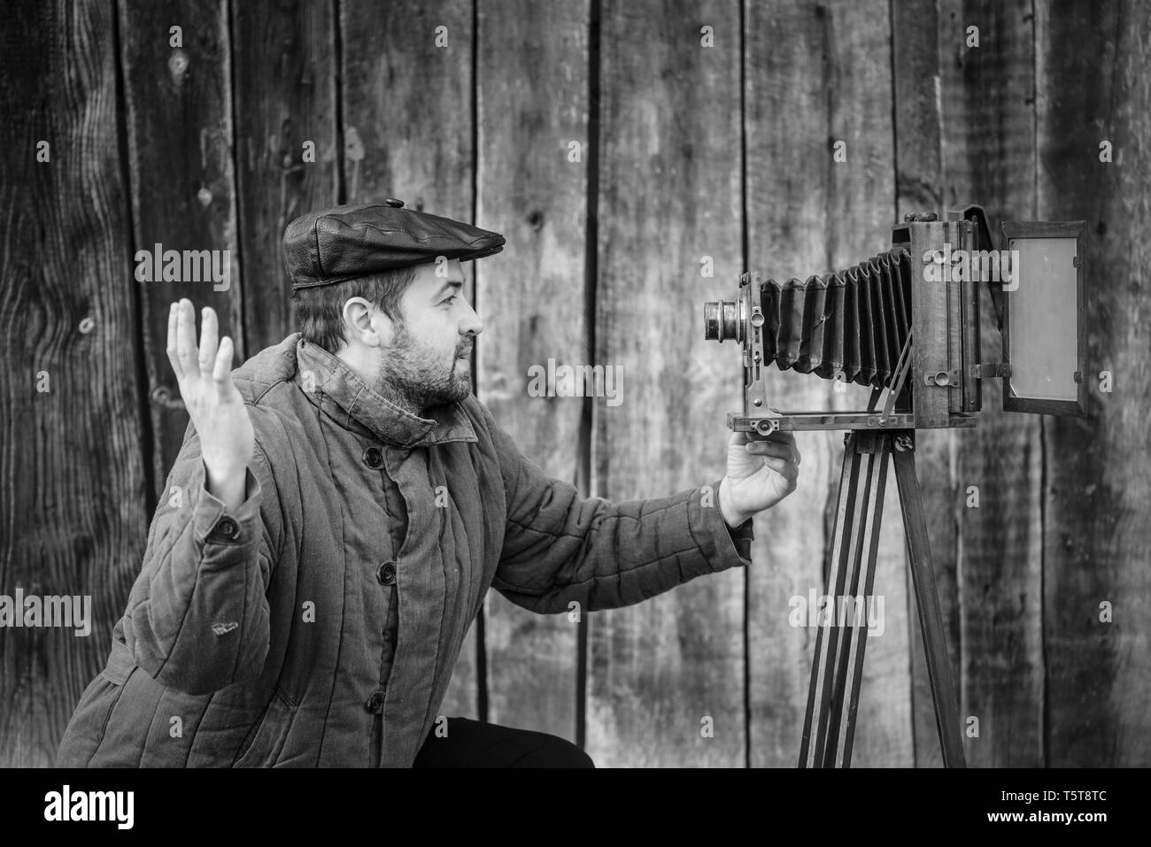 Selfie of old fashioned man on large format camera. Idea- selfie - Stock Image