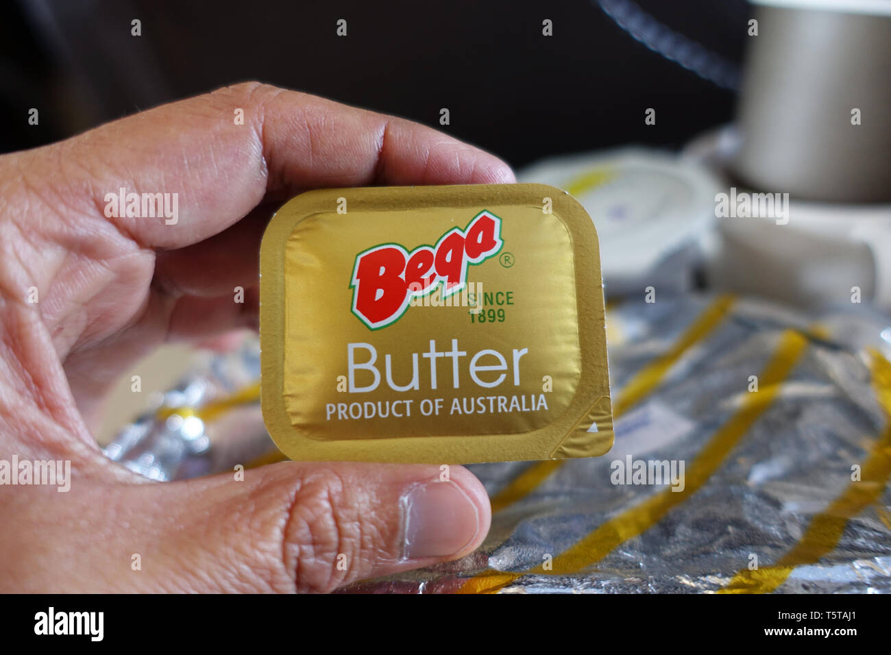 Bega Butter in plastic tub served on Royal Brunei Airlines - Stock Image