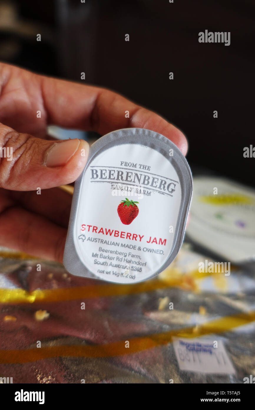 Beerenberg strawberry jam in a tub served on Royal Brunei Airline - Stock Image