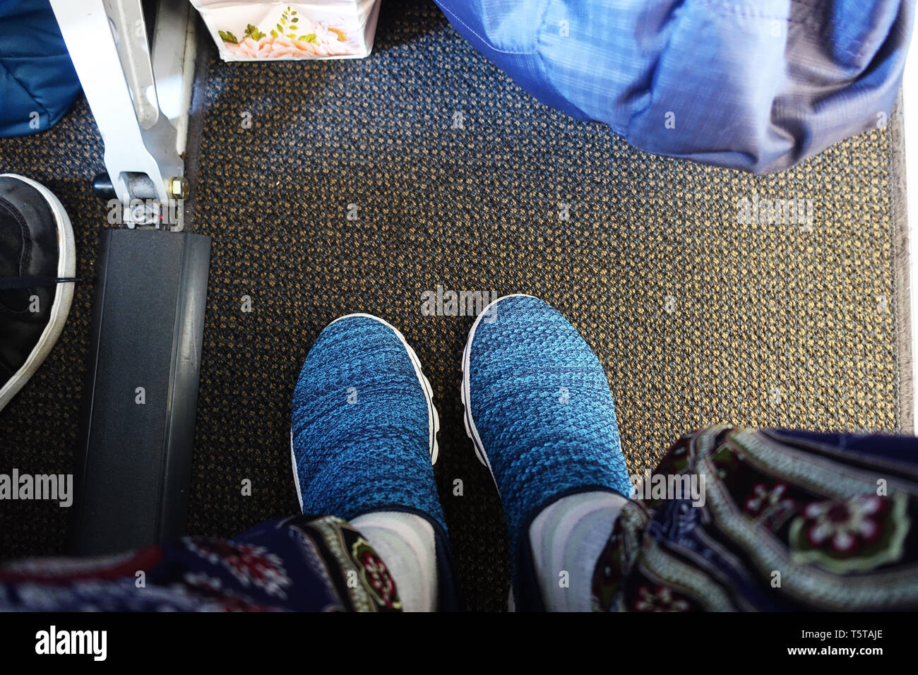 View of the legroom in economy class cabin - Stock Image