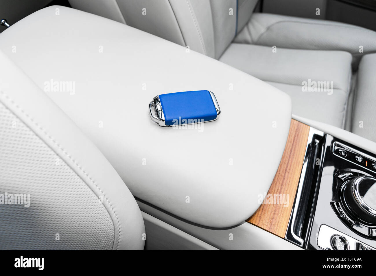 Closeup inside vehicle of wireless blue leather key ignition on