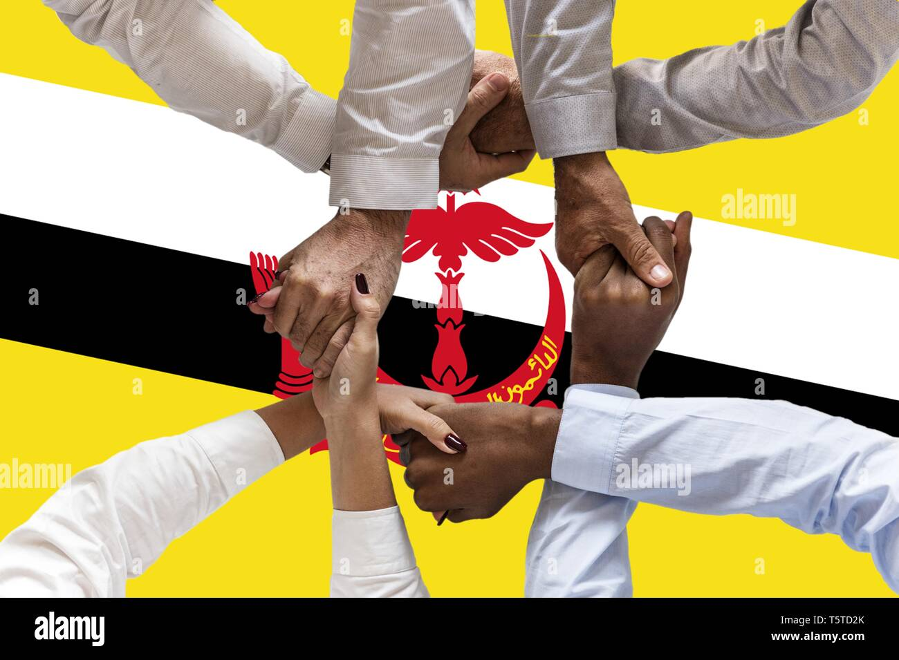 Flag of Brunei, intergration of a multicultural group of young people. - Stock Image