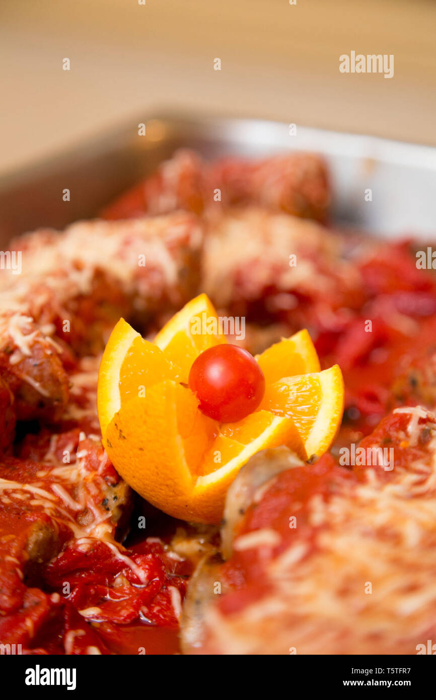 Lasagna in a warming tray for guests at a celebarion - Stock Image