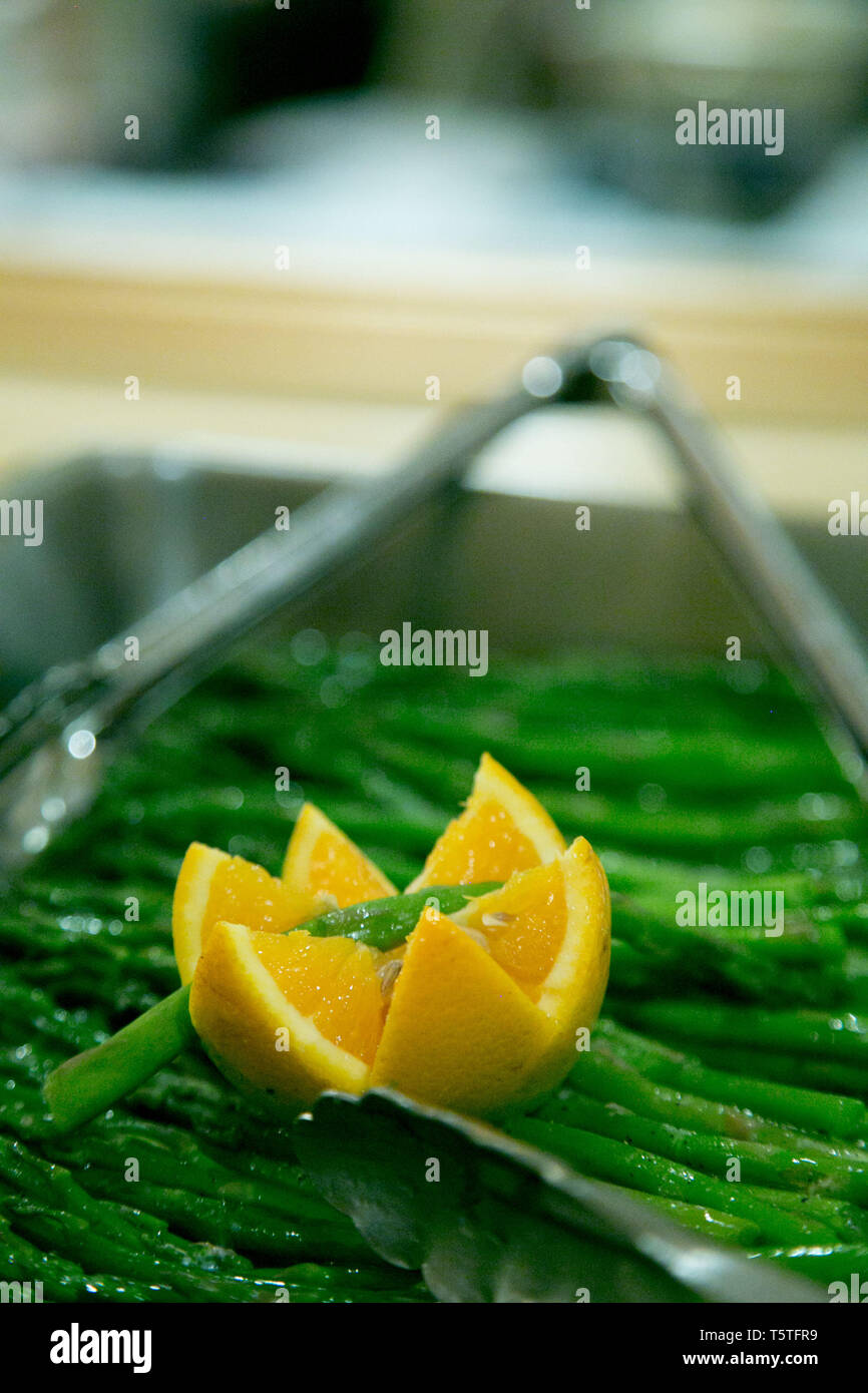 Asparagus in a warming tray for guests at a celebarion - Stock Image