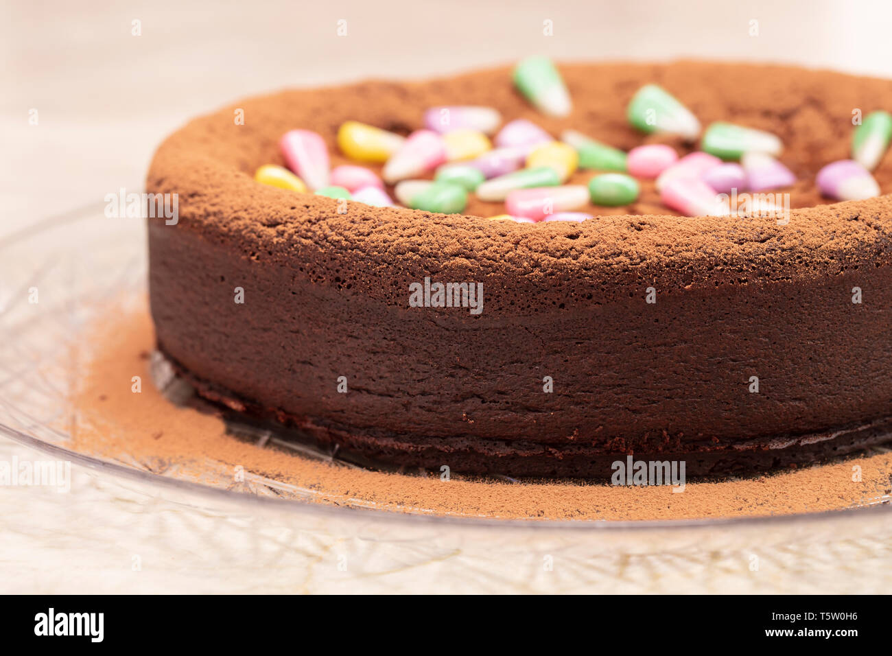 Flourless Dark Chocolate Cake With Pastel Colored Candy Corn On Top On A Clear Serving Plate Stock Photo Alamy