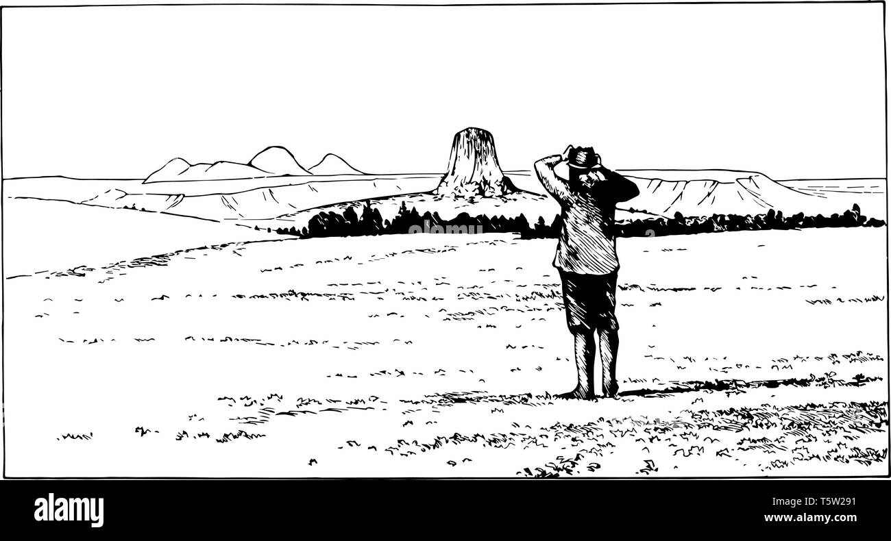Devils Tower formed of igneous rock in crook county above the Belle Fourche River, Wyoming vintage line drawing. - Stock Image