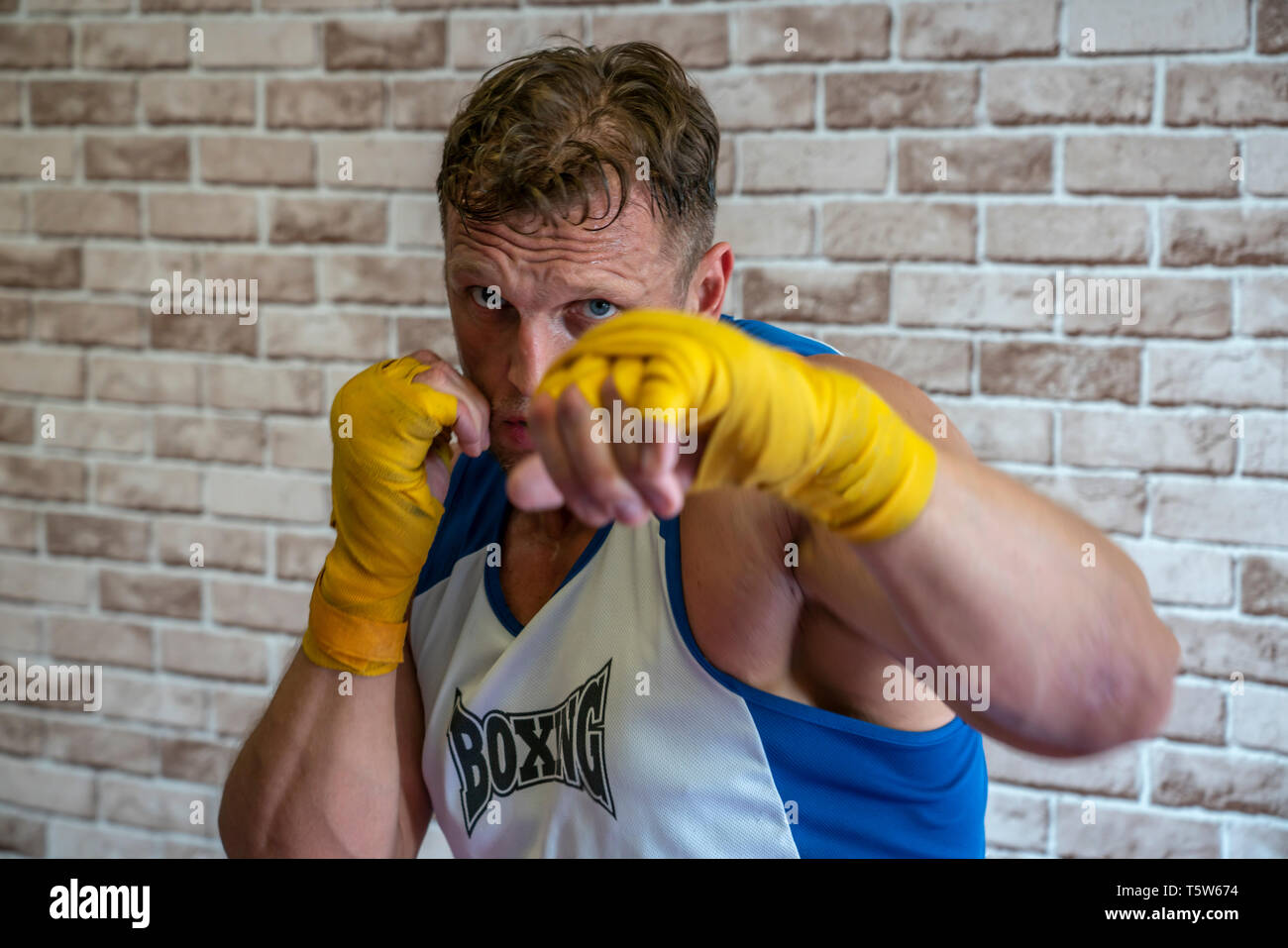 Boxer Boxing with your hands tied bandages on camera - Stock Image