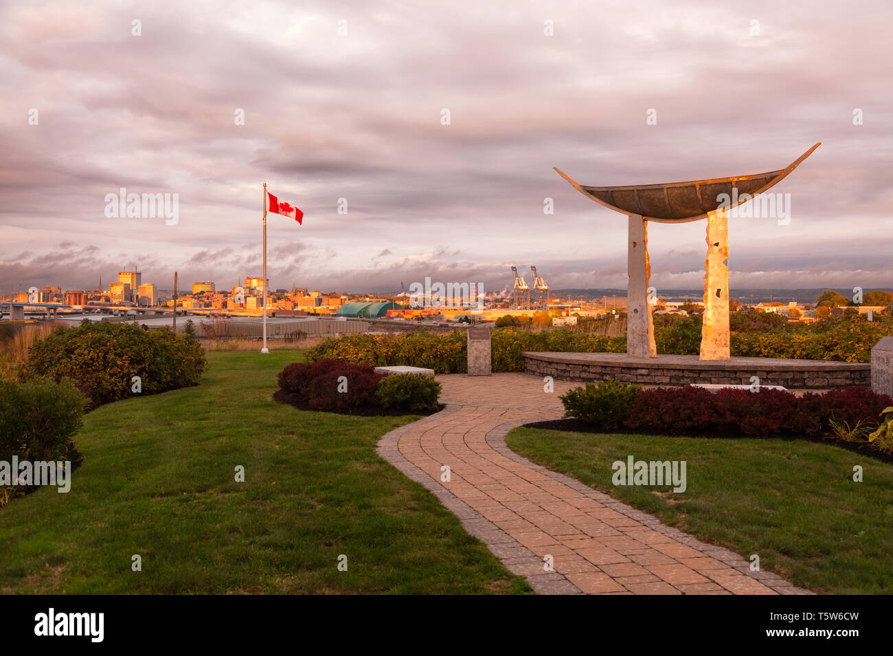 The Memory Vessel sculpture by Peter Powning with the Saint John skyline in the distance in Saint John, New Brunswick, Canada. - Stock Image