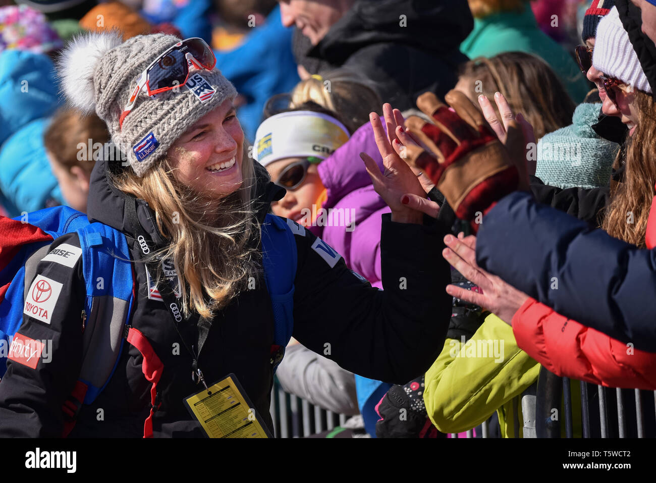 US Cross Country Ski Team member Jessie Diggins (left) high fives fans at the FIS World Cup cross country ski races in Quebec City, Canada, 2019. Stock Photo