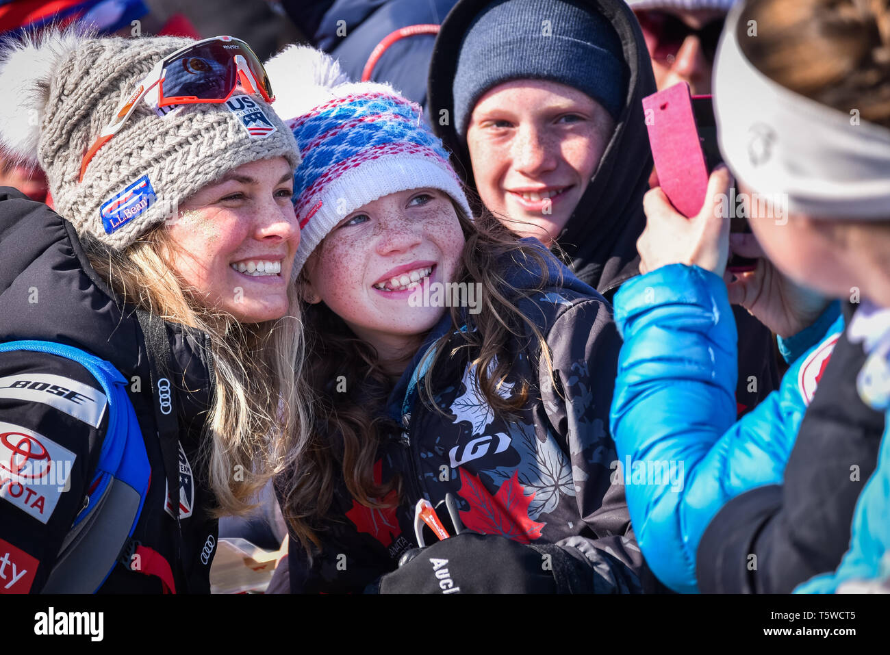 US Cross Country Ski Team member Jessie Diggins (left) poses with fans at the FIS World Cup cross country ski races in Quebec City, Canada, 2019. Stock Photo