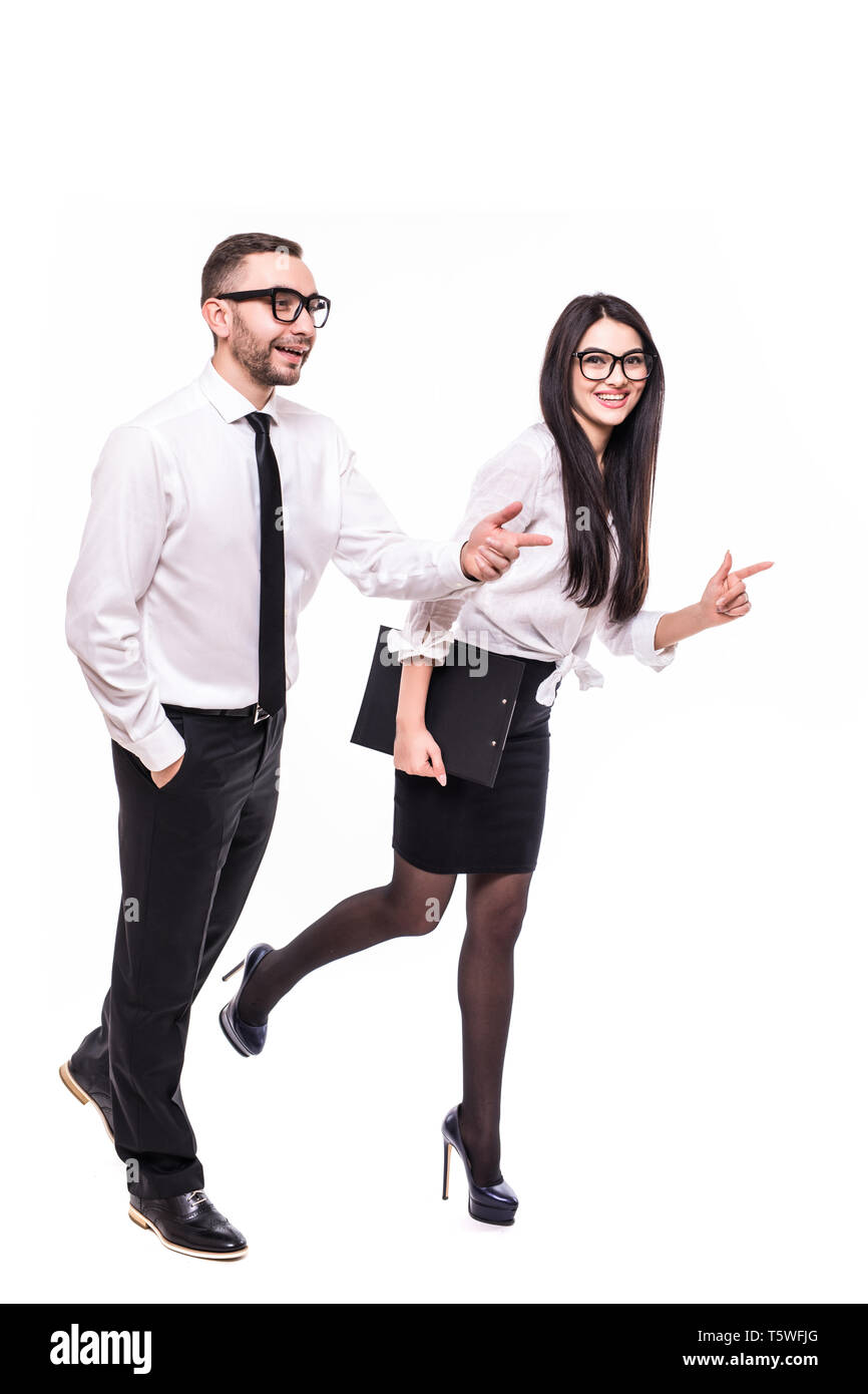 Happy couple running away isolated over gray background, Stock Photo
