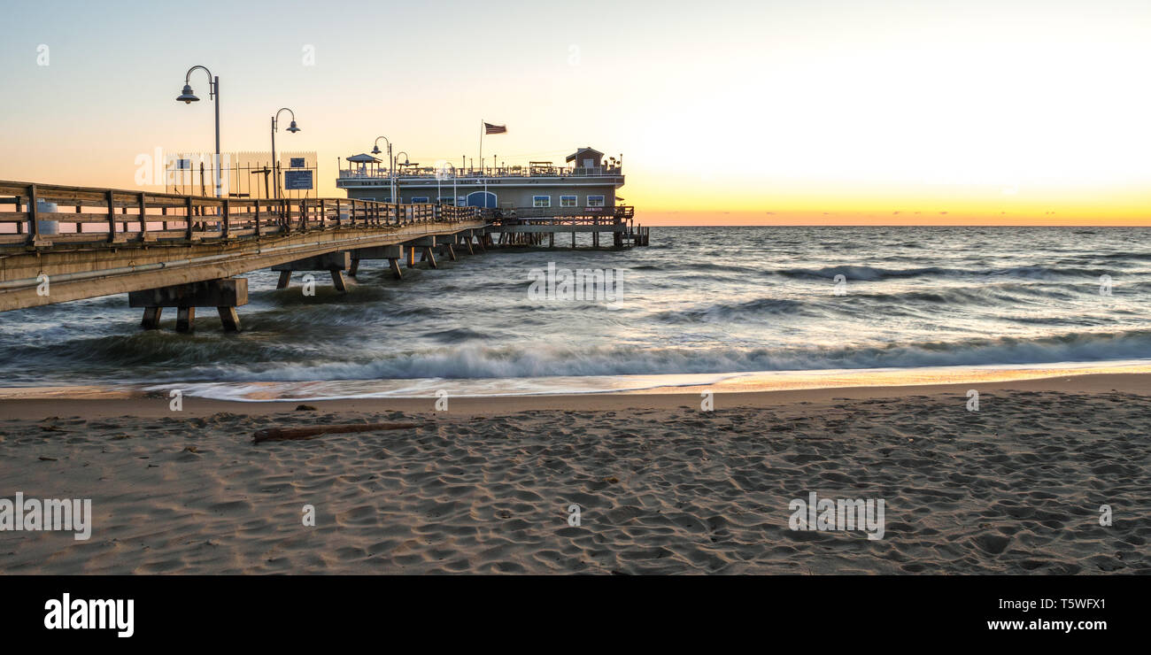 Fishing pier located in the Oceanview area of Norfolk Virginia on the Chesapeake Bay at sunrise - Stock Image